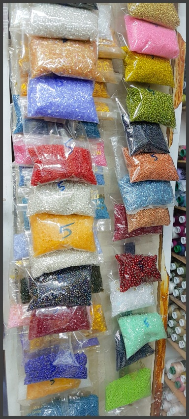 Beads in packets